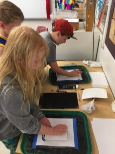 Fourth grade works on block prints of food to go with the food poems they are writing about in class.